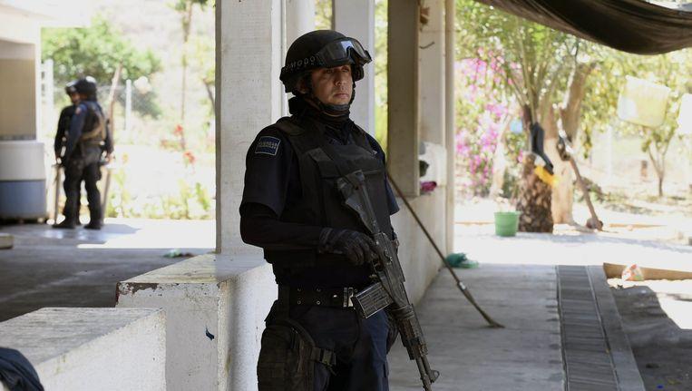 Veiligheidstroepen in Michoacan, waar drugsbendes actief zijn. Beeld AFP