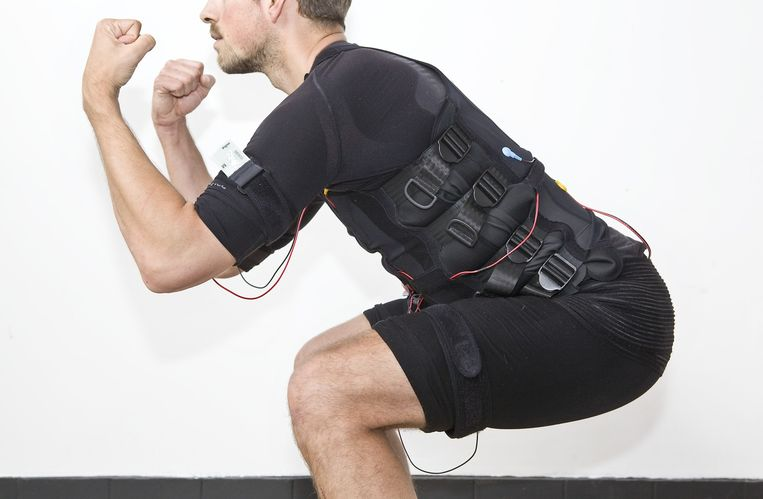 Man in bodytech-outfit Beeld Io Cooman