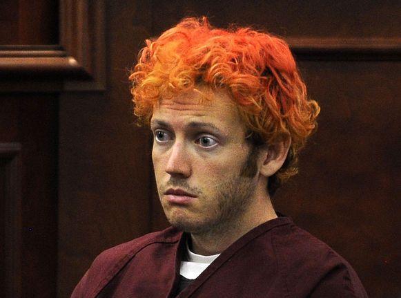 Massamoordenaar James Holmes, net na zijn arrestatie. In 2012 schoot hij in een bioscoop tijdens een Batmanfilm 12 mensen dood en verwondde 70 anderen.