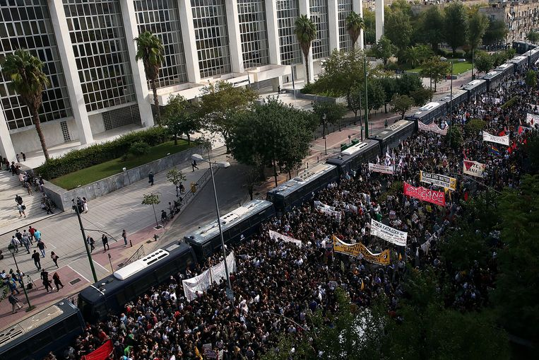 An estimated 20,000 anti-Golden Dawn protesters demonstrated in front of the courthouse.  Social distancing was required.