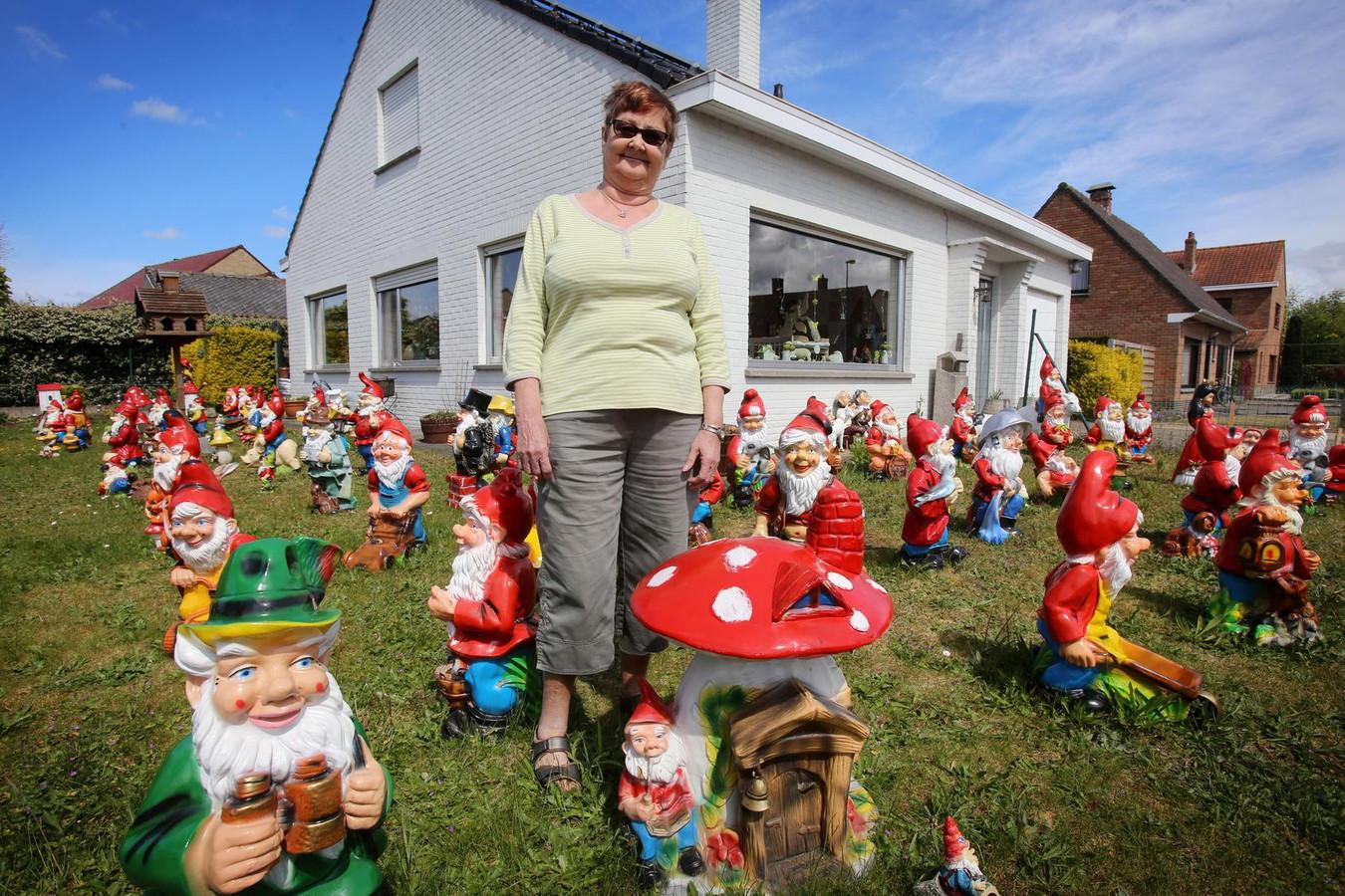 Marleen Gorlias (65) in haar tuin in de Houtsaegerlaan tussen haar 76 tuinkabouters.