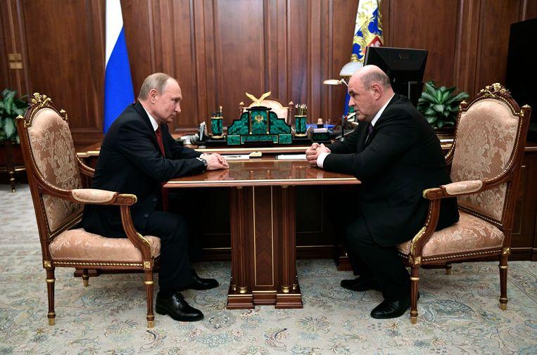 Vladimir Poetin en Michail Misjoestin.
