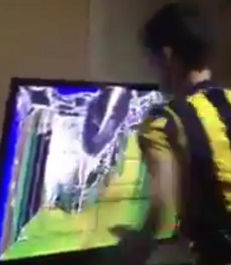 Boze Fenerbahçe-fan slaat gat in tv