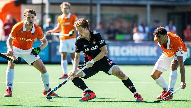Jan-Willem Buissant in actie tijdens de halve finales van play-offs tegen Bloemendaal. Beeld Koen Suyk