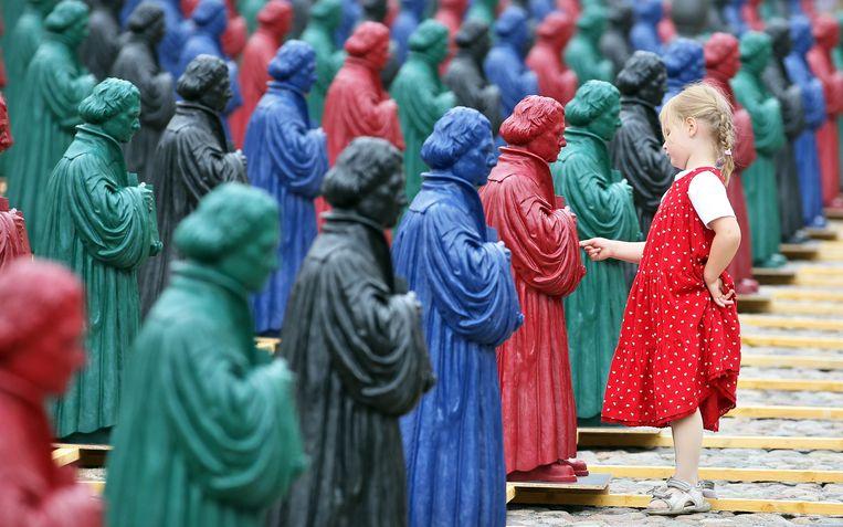 Beelden van Maarten Luther in Wittenberg. Beeld AFP