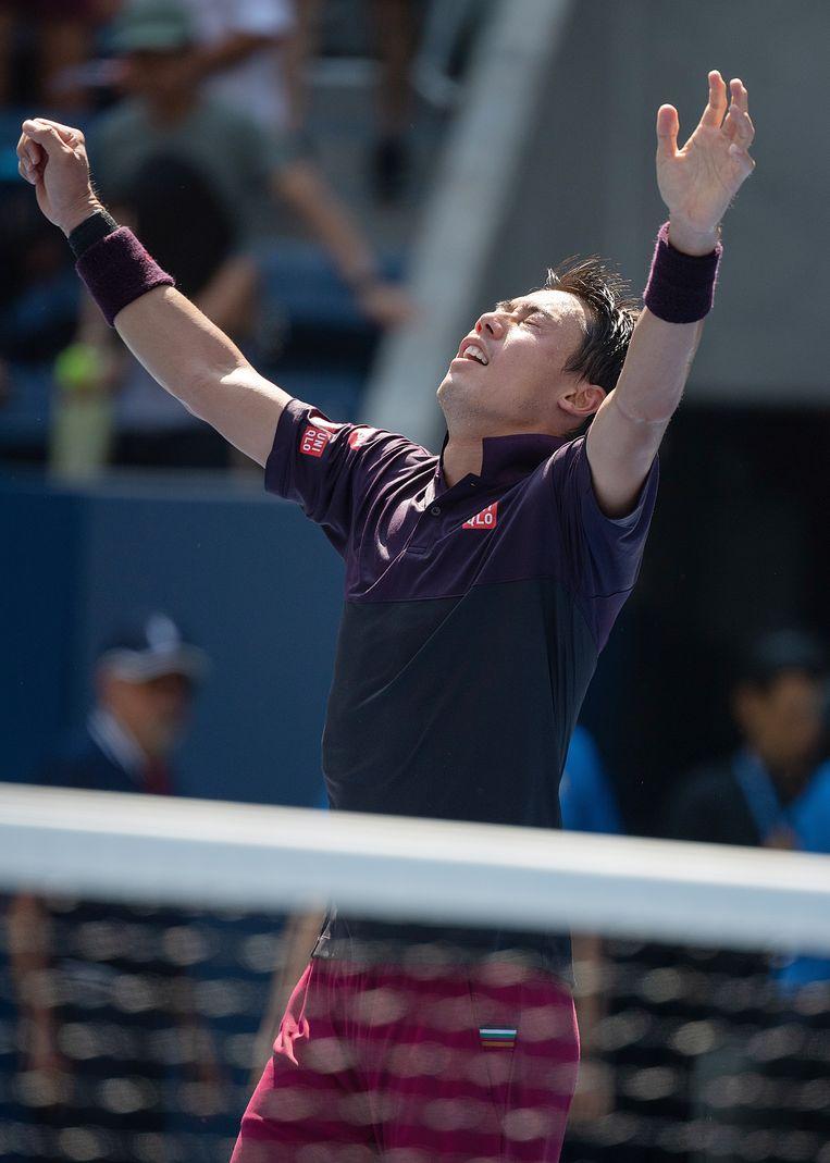 Kei Nishikori viert zijn overwinning op Philipp Kohlschreiber. Beeld EPA
