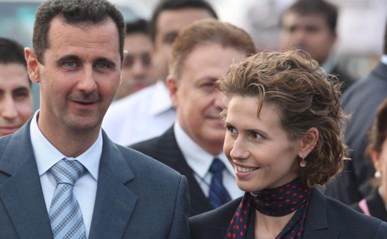 Asma Assad kijkt naar haar echtgenoot. Beeld anp