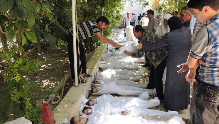 Slachtoffers van de gifgasaanval in Syrië. Beeld null