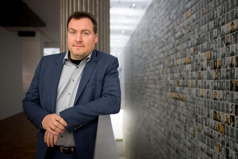 Directeur Christophe Busch.