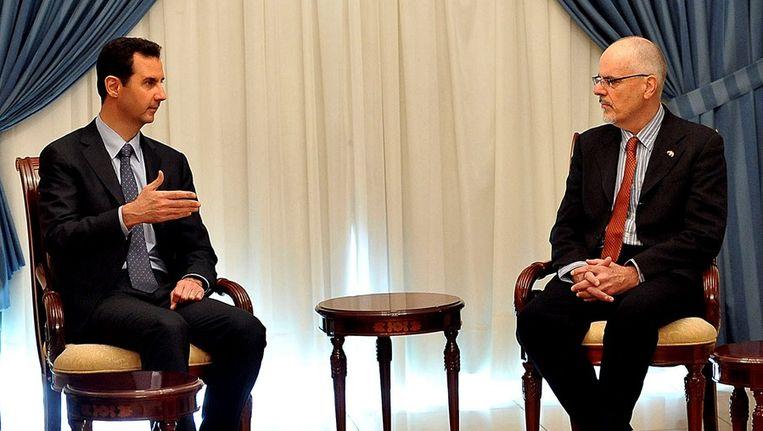 De Syrische president Basjar Assad met de Australische professor Tim Anderson Beeld epa