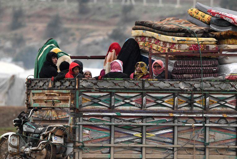 Syriërs op de vlucht voor het geweld.