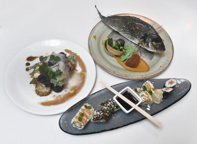 Zeewolf op oosterse wijze, sushi assorti en hele dorade (vlnr)