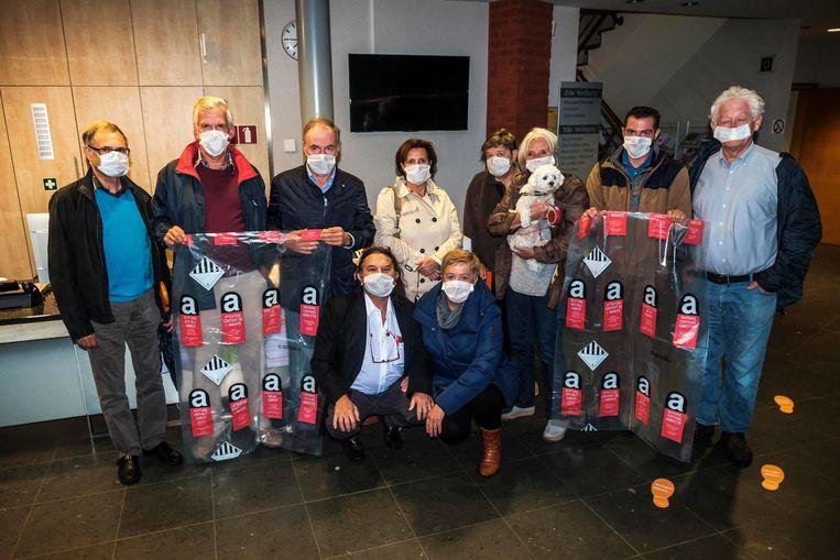 Actiecomité Gezond Verstand protesteerde gisteravond met mondmaskers op de gemeenteraad.