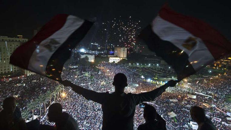 Anti-Morsi-betogers op het Tahrirplein in Caïro op 26 juli van dit jaar. Beeld afp