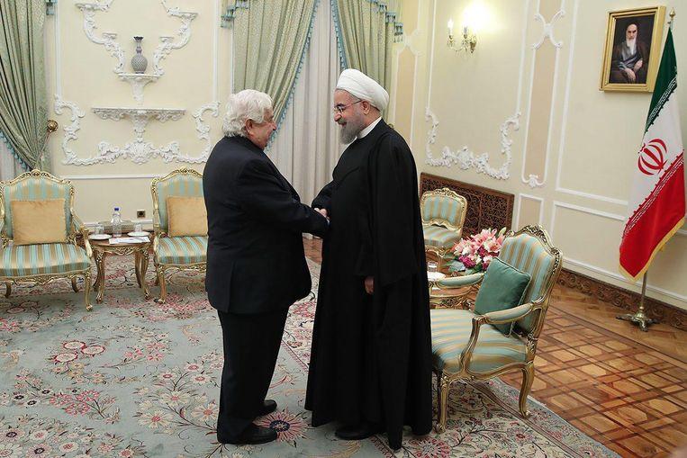 De Iraanse president Hassan Rouhani met de Syrische minister van Buitenlandse Zaken Walid Al-Moalem. Beeld null