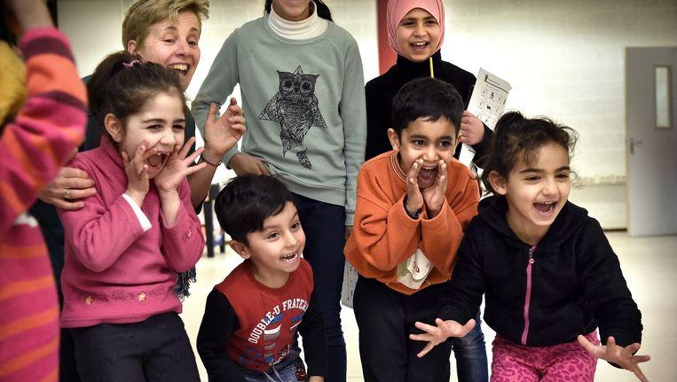 Kinderen van de vluchtelingenschool Heumensoord. Beeld Marcel van den Bergh / de Volkskrant