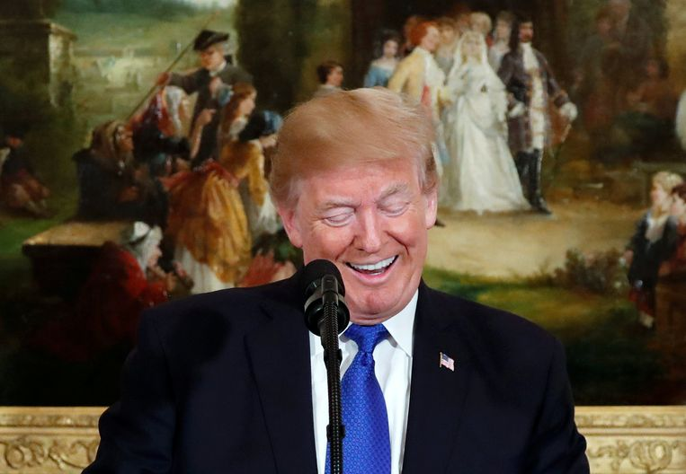 Een lachende president Trump.