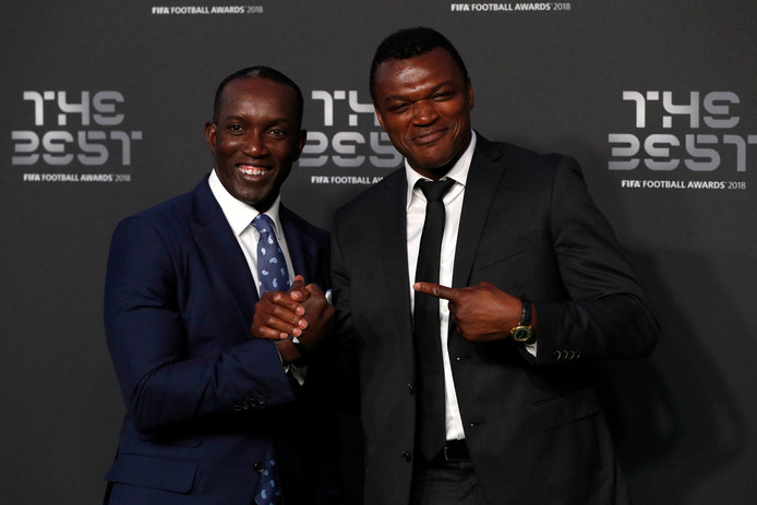 Dwight Yorke (links) en Marcel Desailly.