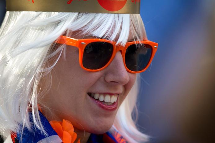 Een Oranjefan op het Lange Voorhout tijdens Prinsjesdag