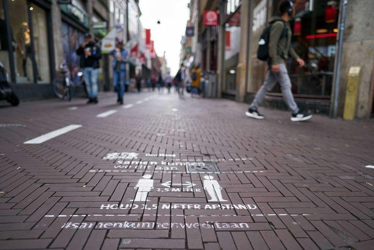Straatbeeld in Den Haag, waar het aantal besmettingen met het coronavirus snel stijgt. Beeld ANP