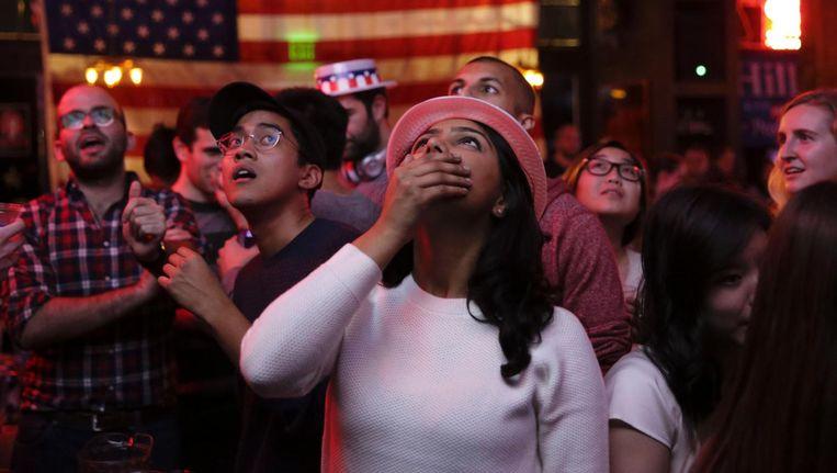 Supporters van Hillary Clinton in Seattle, Washington. Beeld afp