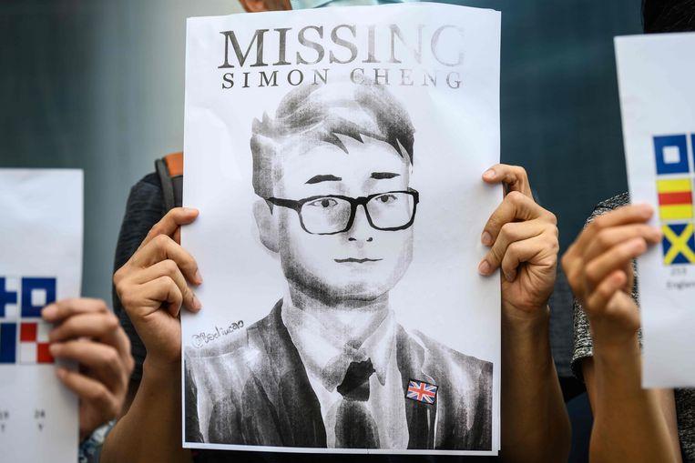 Activisten verzamelden zich afgelopen week voor het Britse consulaat in Hongkong om te protesteren tegen de aanhouding van Simon Cheng.  Beeld null