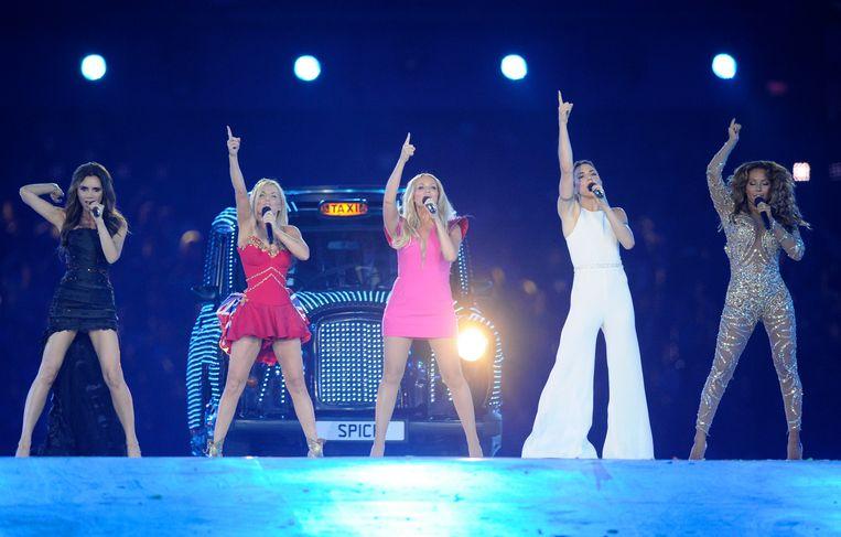 De Spice Girls, met Victoria Beckham links en Mel B rechts, in betere tijden.