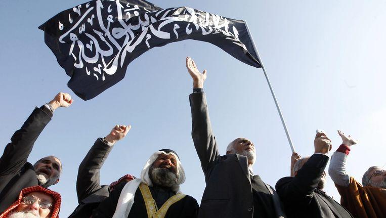 Jordaanse en Syrische aanhangers van Hizb ut Tahrir, vorig jaar bij een betoging in Amman. Beeld epa