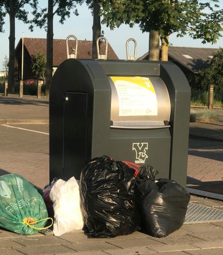 Avri: 'minder vuilniszakken naast ondergrondse containers'