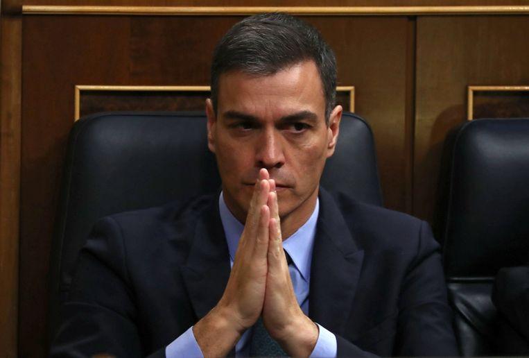 De Spaanse premier Sanchez luistert woensdag naar het begrotingsdebat in het parlement.  Beeld REUTERS