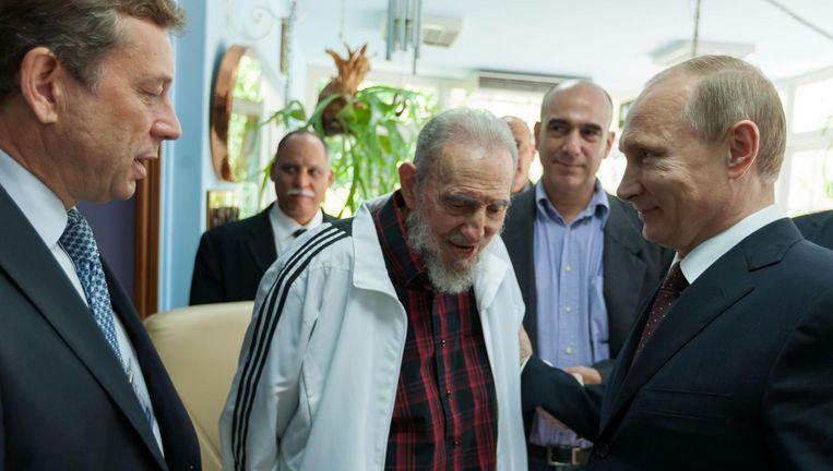 Poetin op bezoek bij Castro in 2014. Beeld afp