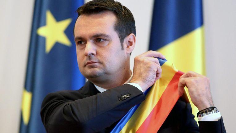 Catalin Chereches bij zijn herintrede als burgemeester van Baia Mare op 18 juli 2016. Beeld epa