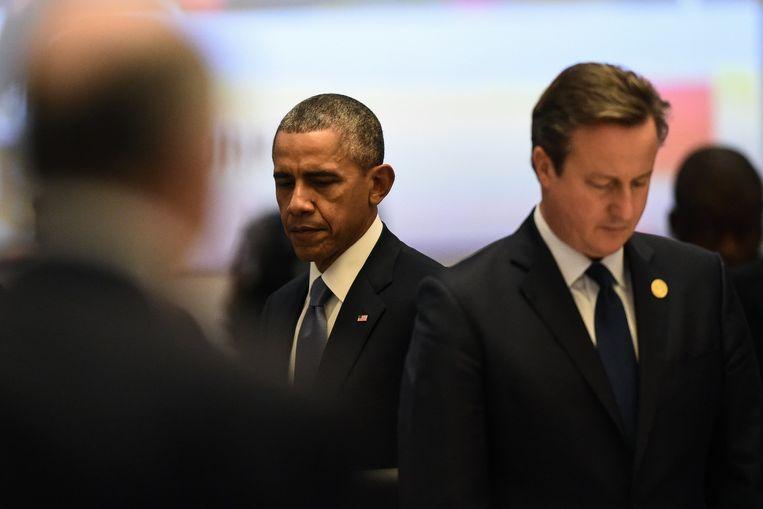 President Obama (l) en premier Cameron (r) op de G20 Beeld anp