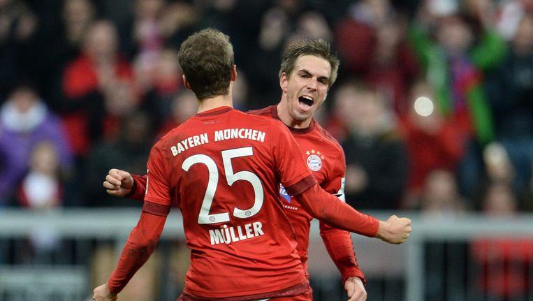 Philip Lahm viert zijn doelpunt met Thomas Müller. Beeld epa