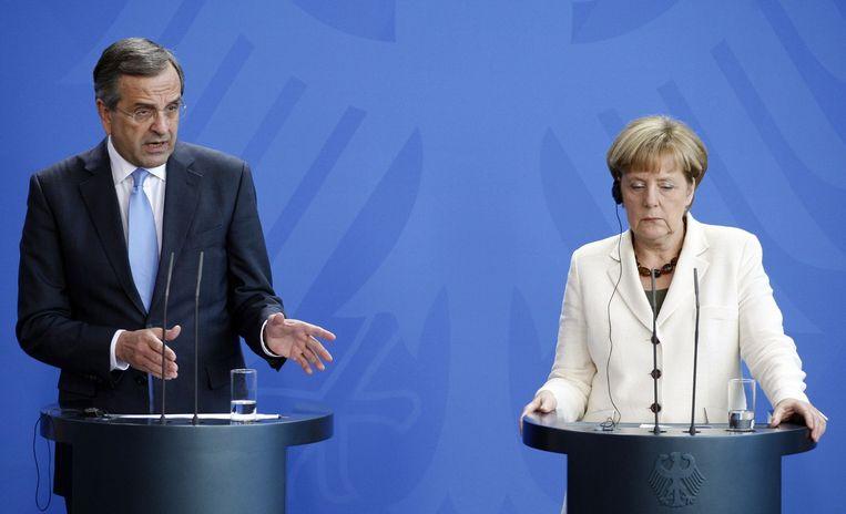 Bondskanselier Merkel vorig jaar met de Griekse premier Samaras. Beeld afp