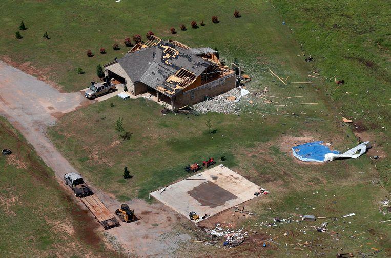 Een door een tornado beschadigde woning nabij Mangum, in Oklahoma.
