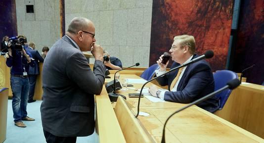 Minister Ard van der Steur van Veiligheid en Justitie (R) en VVD Kamerlid Fred Teeven na afloop van het wekelijkse vragenuurtje in de Tweede Kamer.