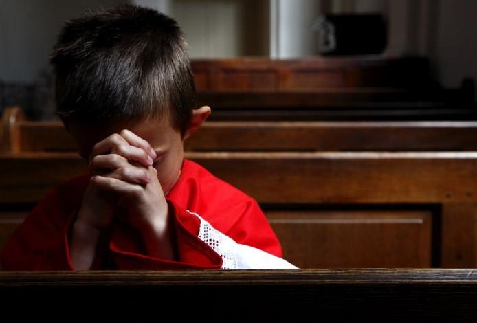 Een jonge misdienaar. Foto: ANP