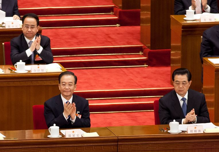 Ling Jihua (linksboven) zit achter de Chinese premier Wen Jiabao (links) en de president Hu Jintao. Beeld ap