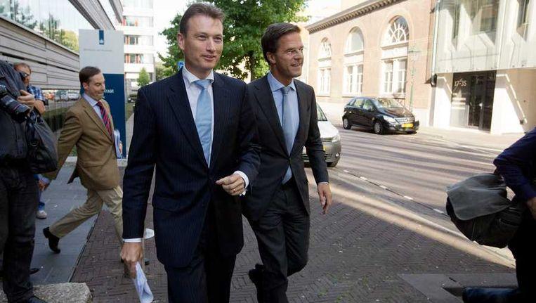 Premier Mark Rutte en VVD-fractievoorzitter Halbe Zijlstra na afloop van het coalitieoverleg. Beeld anp