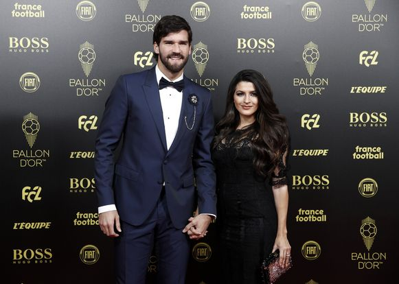 Alisson Becker en partner Natalia.