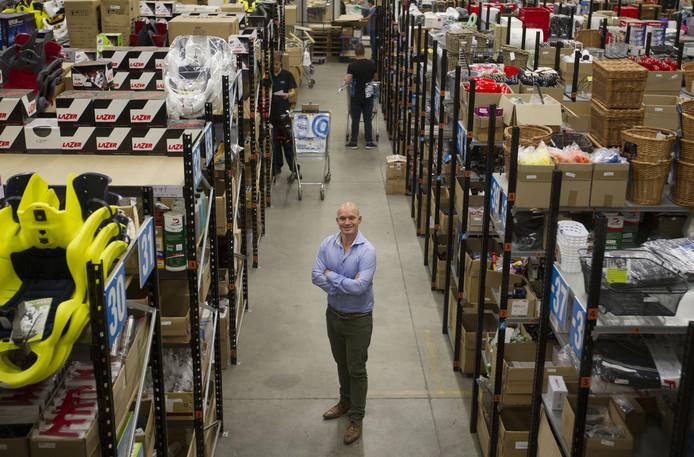 Tom te Riele op archieffoto in het magazijn van T.O.M. in Bladel.