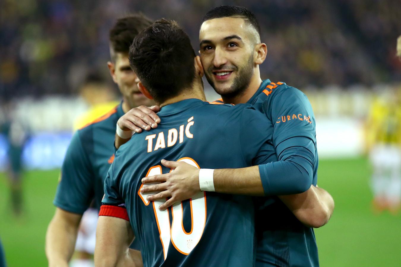 Hakim ZIyech met aanvoerder Dusan Tadic.