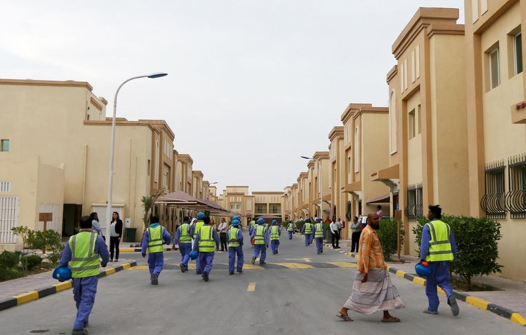 Laborers working on the construction of the football stadium in Al Wakra on their way to their camp. Beeld afp
