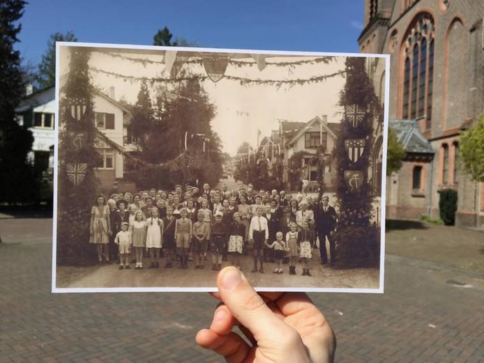 De Piet Joubertstraat, helemaal volgehangen met vlaggen en takken. De hele buurt werd opgetrommeld voor deze foto.
