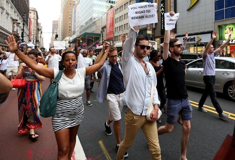 Vreedzame protesten op donderdagavond in Dallas. Beeld EPA