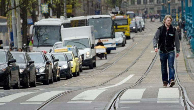 Het GVB voerde afgelopen donderdag actie tegen de kabinetsplannen met het stadsvervoer in de drie grote steden. Tussen de ochtend- en avondspits reden er geen bussen, trams en metro's. Beeld