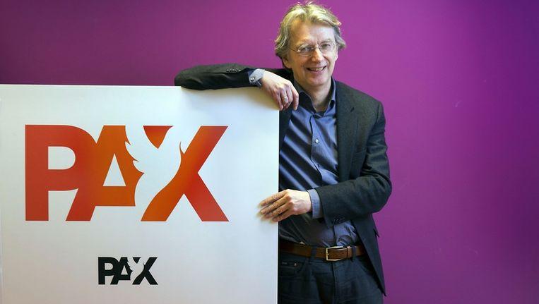 Directeur Jan Gruiters met zijn nieuwe logo Beeld Werry Crone