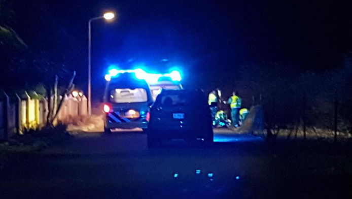 Hulpdiensten in Kralendijk na de moord op de Nederlandse politieagent.
