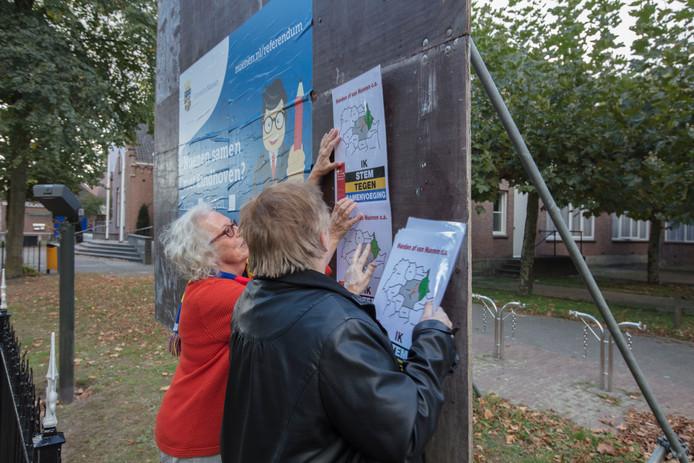 Actiegroep tegen fusie Nuenen Eindhoven hangt pamfletten op in Nuenen